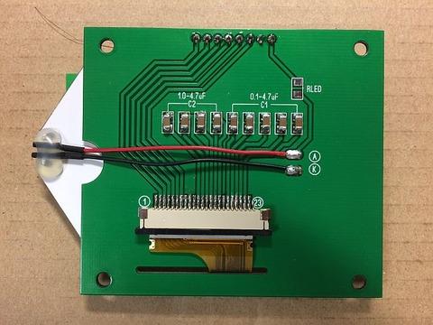 2.7インチSTNシリアル液晶モジュール 2P-S60779 (解像度:128x64ドット、液晶コントローラ:ST7565R)の基盤裏面への部品実装を行いました。